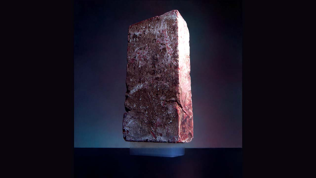 Aerogel with a mass of 2 grams supporting a 2.5 kg brick. (Wikipedia)