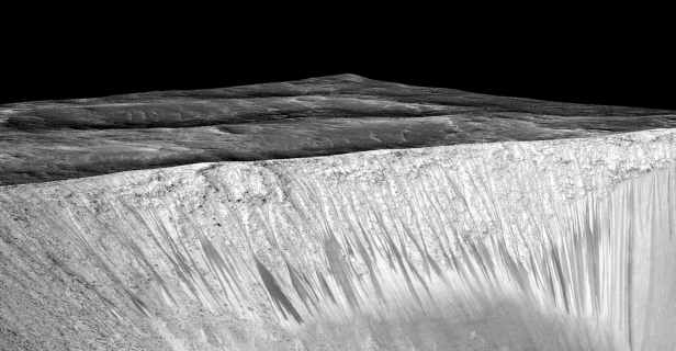 Dark narrow streaks called recurring slope lineae emanating out of the walls of Garni crater on Mars are seen in a NASA handout image